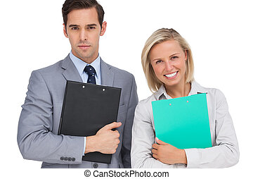 Happy business people standing toge