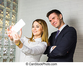 business people taking selfie with phone