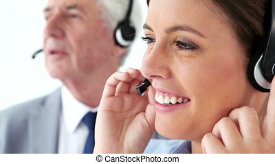 Happy business people using headsets