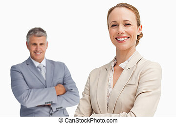 Happy business people with folded arms
