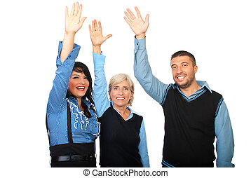 Happy business people with hands up