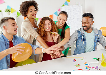 happy business team at office party holding hands -...