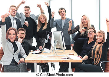happy business team at the workplace in the office