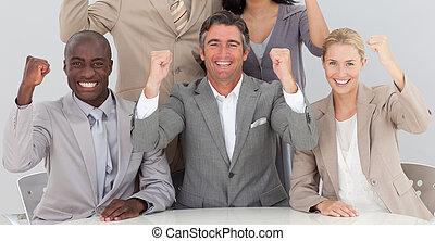 Happy business team celebrating a success