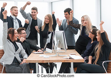 happy business team celebrating in the workplace