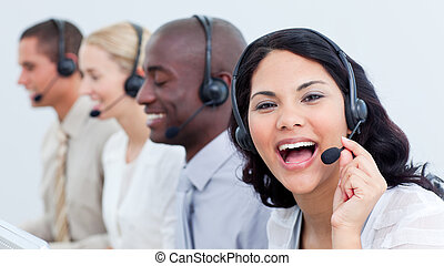 Happy business team in a call center