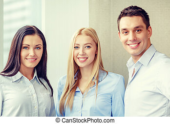 happy business team in office - business and office concept...