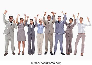 Happy business team raising their arms