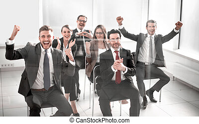 happy business team sitting in conference room.