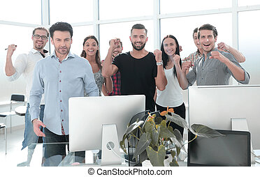 happy business team standing in modern office