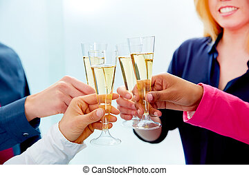 Happy business team toasting with champagne