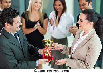 business team winning a trophy