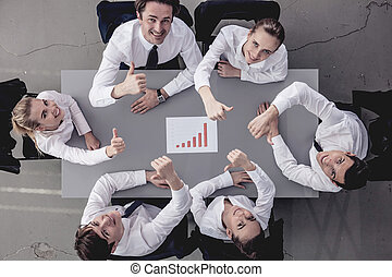 Happy business team with report