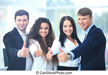 Happy business team with thumbs up in the office