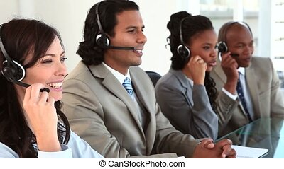 Happy business team working with headsets