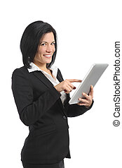 Happy business woman browsing a tablet reader and looking at camera