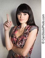 business woman holding her index finger up