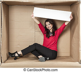 happy business woman holds a copy space