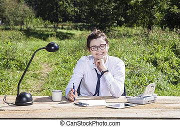 Happy business woman in her field office