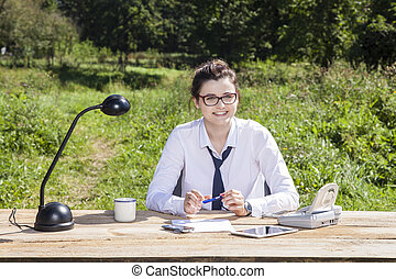 Happy business woman in his office in the park