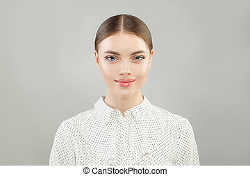 Happy business woman in white shirt portrait