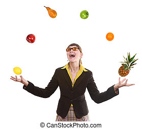 woman juggling fruit - happy business woman juggling fruit...