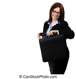 happy business woman looking at her watch on white background