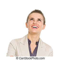 Happy business woman looking up on copy space