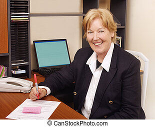 Happy business woman in office