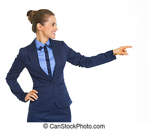 Happy business woman pointing on copy space