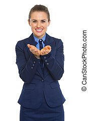 Happy business woman presenting something on empty palm