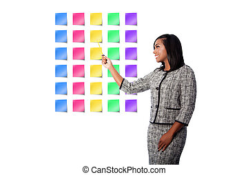 Happy business woman presenting sticky notes