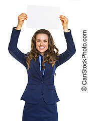Happy business woman showing blank paper sheet