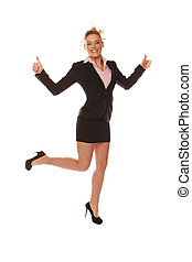 Happy business woman showing thumbs up - Studio shot of...