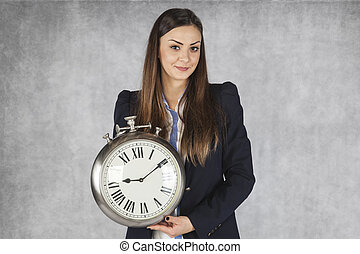 happy business woman shows a clock