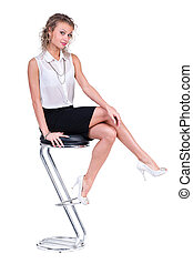 Happy business woman sitting on a chair, isolated over white