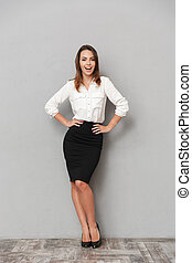 Happy business woman standing isolated