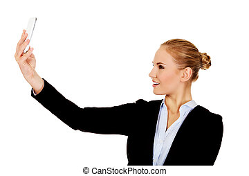 Happy business woman taking selfie photo smartphone