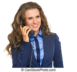 Happy business woman talking phone