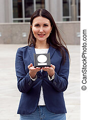 Happy Business woman with award