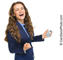 Happy business woman with calculator rejoicing