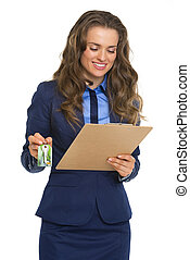 Happy business woman with clipboard and keys