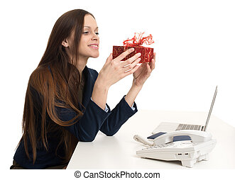 Happy business woman with present box
