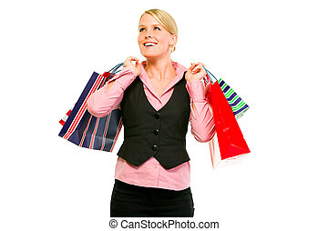 Happy business woman with shopping bags