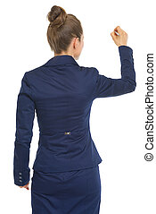 Happy business woman writing in air. rear view
