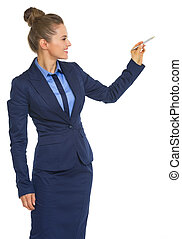 Happy business woman writing in air with pen