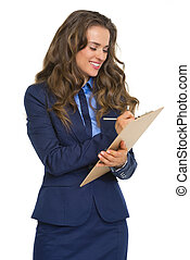 Happy business woman writing something in clipboard