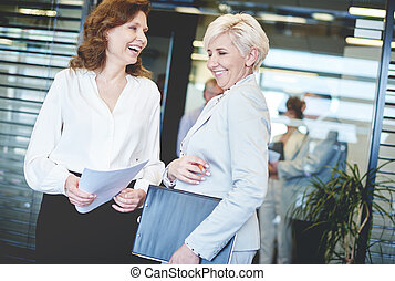 Happy business women in the office building