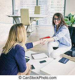 Happy business women shaking hands
