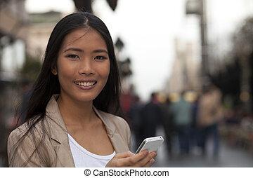 Happy business women using smart phone